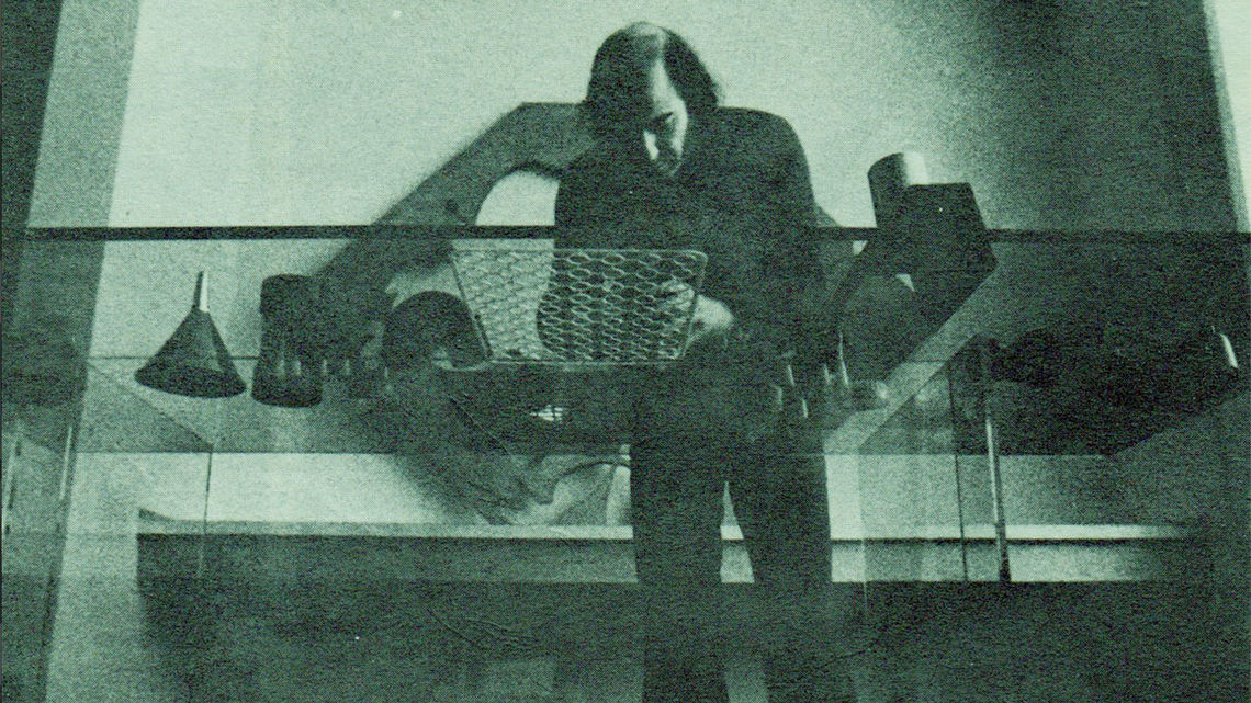 Roy Ascott setting-up Plastic Transactions at the president's office desk, Ontario College of Art and Design, 1971